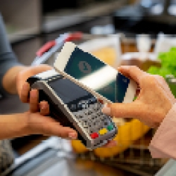 picture of someone paying with their phone