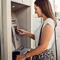 picture of a woman using an ATM