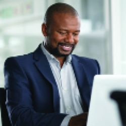 picture of a man looking at a computer