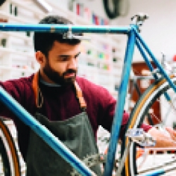 Picture of a man working at his bike